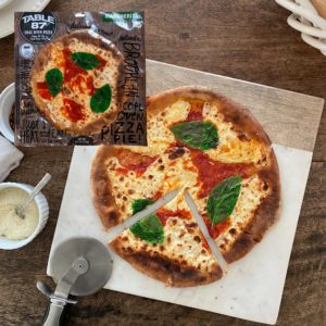 Margherita Pizza Plated Cut 1 Pie Feature